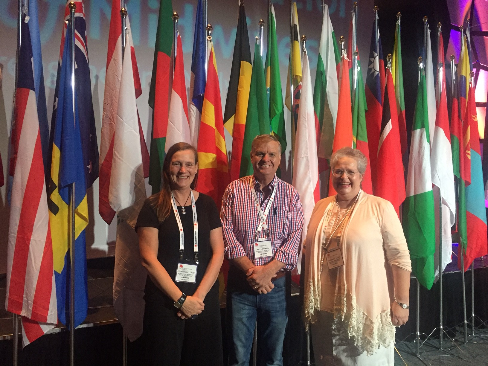 Members of the NMBA and the AHPRA midwifery policy team stand in front of national flags at ICM Congress 2017