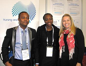 Photo of Board exhibition booth with David Tenkorang-Twum, Helen Lorna Ngul and Kristy Mutsaers